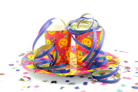 colorful party cups with streamers over white background photo