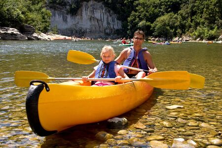 Father and daughter in canoe enjoying the holidays