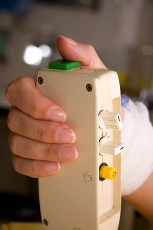 a patients hand is pushing the nurse call button in hospital photo