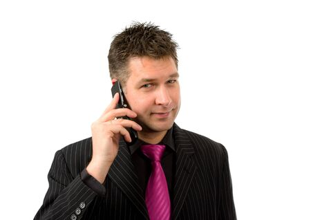 Businessman is on the phone looking at camera over white background photo