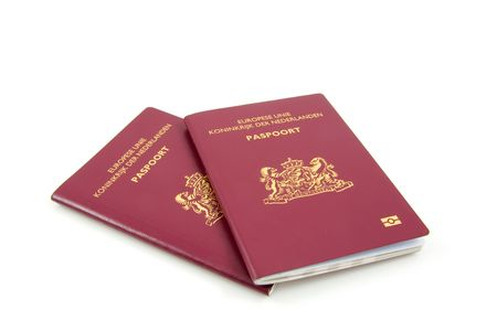 Two Dutch passport isolated on white background Stock Photo - 5697029