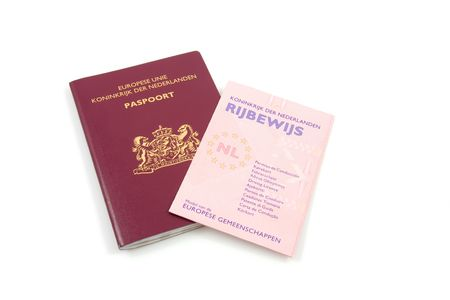 licence: Dutch drivers licence and passport isolated on white background Stock Photo