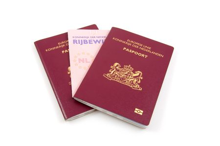 Dutch drivers licence and passport isolated on white background photo