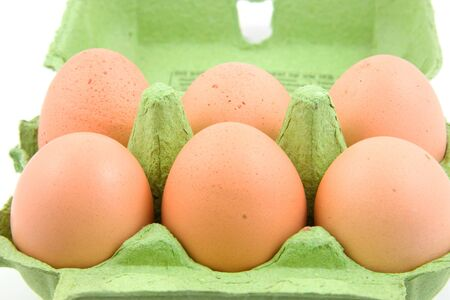 Six chicken eggs in green carton box Stock Photo - 5696806
