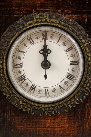 oclock: Big clock strikes twelve oclock in closeup