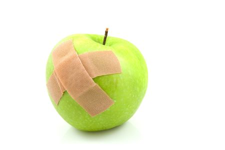 nursing sister: Sick green apple with patches isolated on white background Stock Photo
