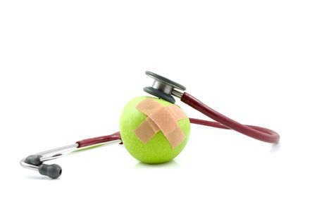nursing sister: sick apple with patches and stethoscope isolated on white background Stock Photo