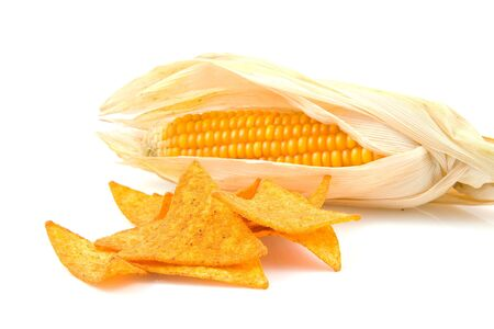 Tortilla chips with mais corn over white background Stock Photo