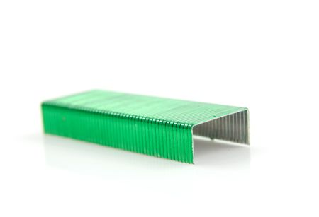 staples: Green staples in closeup over white background