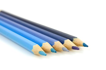 blue pencils in closeup over white background photo