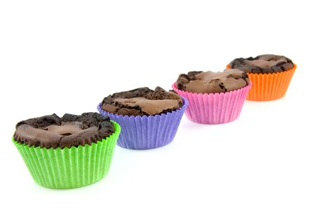 Home baked brownie cupcakes in colorful cups, isolated on white background photo