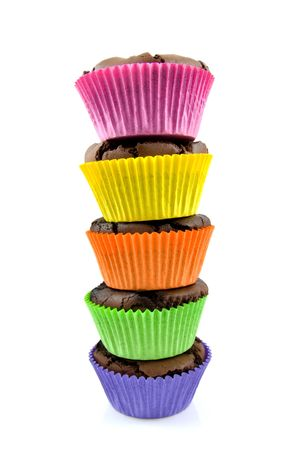 stack Home baked brownies cupcakes in colorful cups, isolated on white background Stock Photo