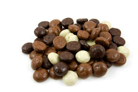 gingernuts: chocolate gingernuts, pepernoten,over white background. Tyical Dutch candy for 5 december. Stock Photo