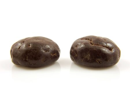 Two chocolate ginger nuts in closeup, also known as pepernoten, a typical dutch treat for Sinterklaas Stock Photo - 5823839