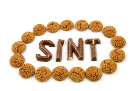gingernuts: The word Sint in chocolate letters with circle of ginger nuts isolated on white background, typical Dutch candy for Sinterklaas event in december