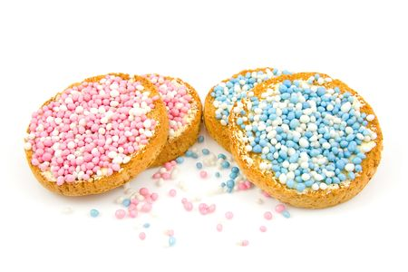 Rusk with blue and pink mice to celebrate the birth of a child, over white background Stock Photo