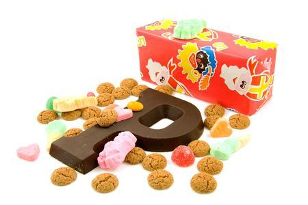 gingernuts: Typical Dutch event: Sinterklaas in december with present and candy over white background Stock Photo