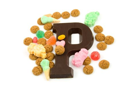 Typical Dutch event: Sinterklaas in december with chocolate letter and candy over white background Stock Photo - 5875757