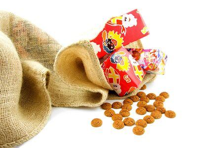 zak: Typical Dutch celebration: Sinterklaas with presents in bag and ginger nuts, ready for the kids in december