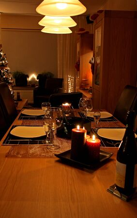 Romantic table set for christmas dinner with candles photo