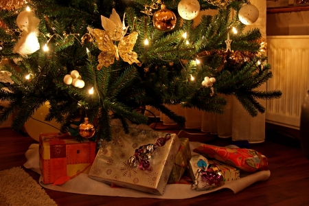 lots of beautiful presents under christmas tree photo