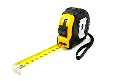 Yellow measure tool isolated on white background photo