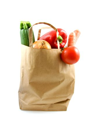 paper shopping bag with grocery over white background photo