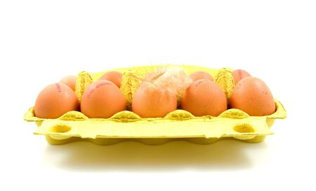 ten chicken eggs in yellow box over white background Stock Photo - 5961641