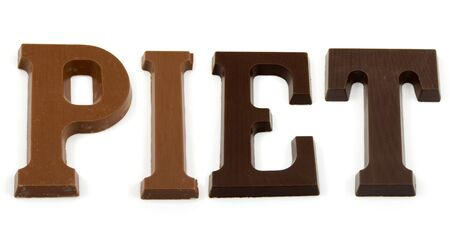 pieten: The word PIET in chocolate letters isolated on white background, typical Dutch candy for Sinterklaas event in december