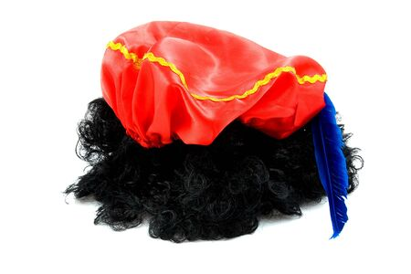 pieten: red hat with blue feather and black hair of Zwarte Piet, typical Dutch event in december