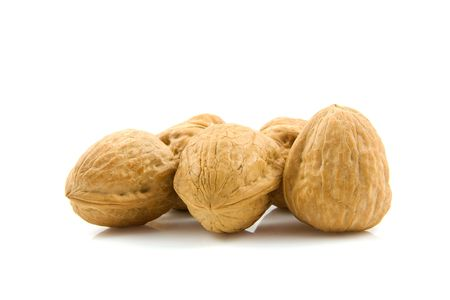 noix: some walnuts isolated on white background