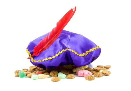 zwarte piet: purple hat with red feather of Zwarte Piet and ginger nuts, typical Dutch event in december Stock Photo