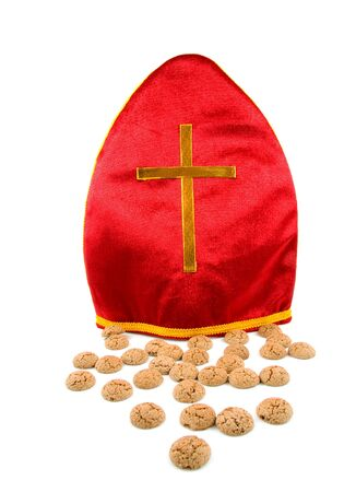 Mitre also known as mijter of Sinterklaas and pepernoten, part of typical Dutch tradition, isolated on white background photo