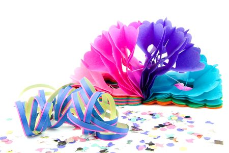 colorful party streamers and confetti for birthday over white background photo