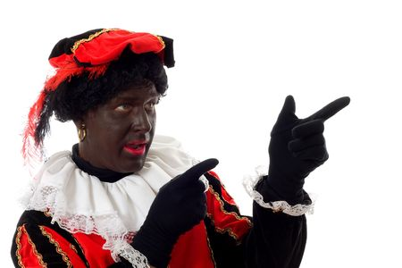 Zwarte piet ( black pete) typical Dutch character part of a traditional event celebrating the birthday of  Sinterklaas in december over white background throwing pepernoten ( ginger nuts) Stock Photo - 6037997