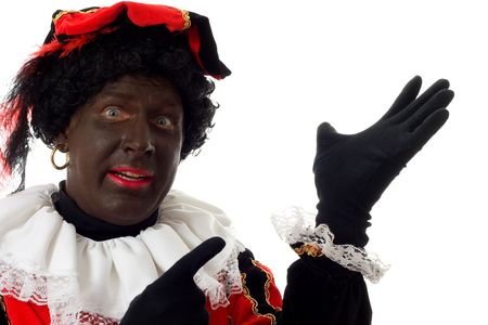Zwarte piet ( black pete) typical Dutch character part of a traditional event celebrating the birthday of  Sinterklaas in december over white background Stock Photo - 6037998