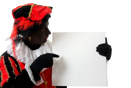 Zwarte piet ( black pete) typical Dutch character part of a traditional event celebrating the birthday of  Sinterklaas in december over white background is holding empty text board Stock Photo - 6038002