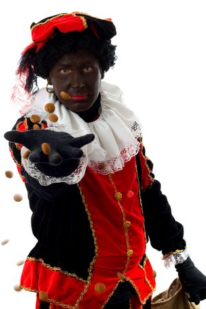 nicolaas: Zwarte piet ( black pete) typical Dutch character part of a traditional event celebrating the birthday of  Sinterklaas in december over white background throwing pepernoten ( ginger nuts)