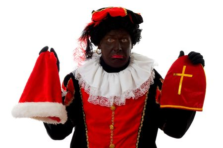 black pete: Zwarte piet ( black pete) typical Dutch character part of a traditional event celebrating the birthday of  Sinterklaas in december over white background holding Santas hat
