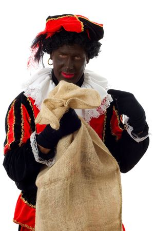 nicolaas: Zwarte piet ( black pete) typical Dutch character part of a traditional event celebrating the birthday of  Sinterklaas in december over white background with bag