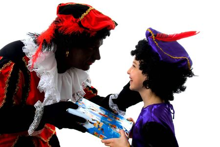saint nicolaas: Zwarte piet ( black pete) typical Dutch character part of a traditional event celebrating the birthday of  Sinterklaas in december over white background with young child