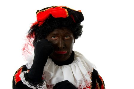 black pete: sad Zwarte piet ( black pete) typical Dutch character part of a traditional event celebrating the birthday of  Sinterklaas in december over white background