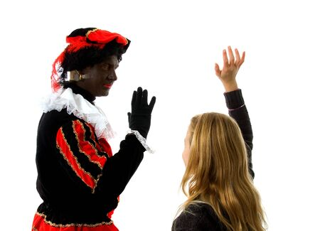 black pete: Blonde girl waves goodbye to Zwarte piet ( black pete) typical Dutch character part of a traditional event celebrating the birthday of  Sinterklaas in december over white background