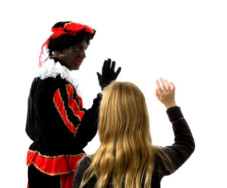 Blonde girl waves goodbye to Zwarte piet ( black pete) typical Dutch character part of a traditional event celebrating the birthday of  Sinterklaas in december over white background Stock Photo - 6037992
