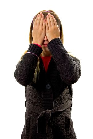 Young blonde girl covers her eyes: see no evil, isolated on white background Stock Photo - 6038004