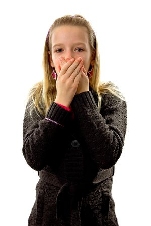Young blonde girl covers her mouth: speak no evil, isolated on white background Stock Photo - 6038001