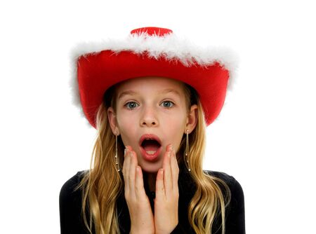 Girl with christmas hat lookes amazed over white background Stock Photo - 6038010