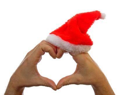 cuore in mano: Mani cuore forma con cappello di Natale su sfondo bianco