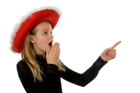 Girl with christmas hat looks amazed over white background Stock Photo - 6085794