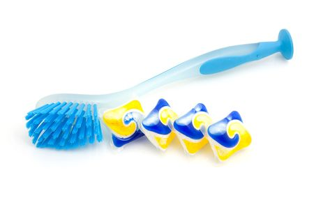 blue dishwashing brush and tablets for machine isolated on white background Stock Photo - 6124160
